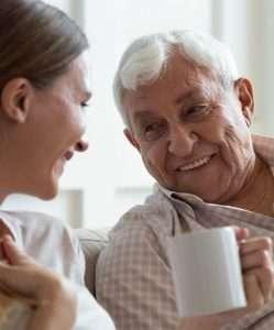 Grandad enjoying a cup of tea with daughter