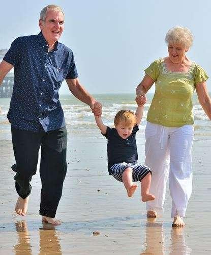 Grandparents and grandchild on the beach